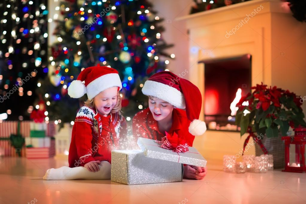 Kids opening Christmas presents — Stock Photo © FamVeldman #87526926