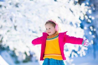 Child in snowy winter park
