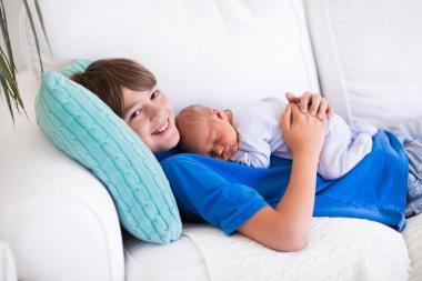 Child holding newborn sibling