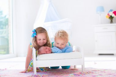 Little boy and girl meet new sibling