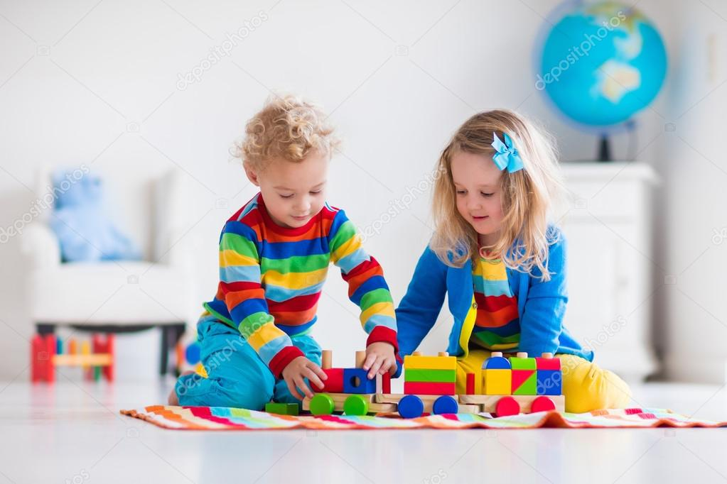 Toddler Toys Photography : Kids playing with wooden toy train — stock photo