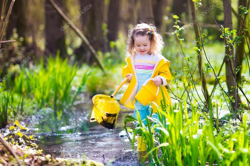 Little girl catching a frog