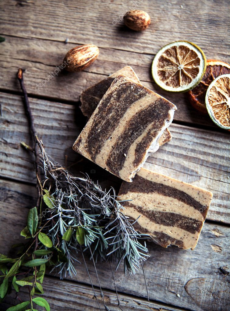 Natural cosmetics. Organic scrub soap on wooden background. Purification, healthy skin and a beautiful body. Lavender and citrus.