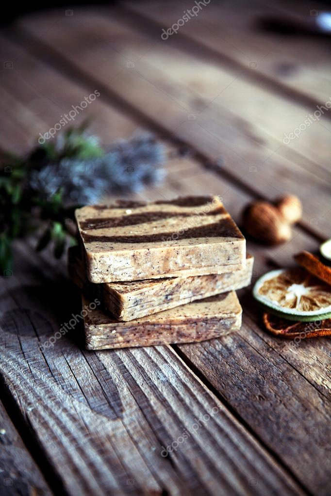 Natural cosmetics. Organic scrub soap on wooden background. Puri