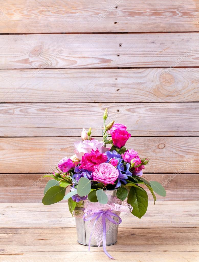 flowers. bouquet of roses on a wooden background
