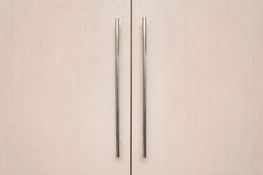 light brown doors with metal handles
