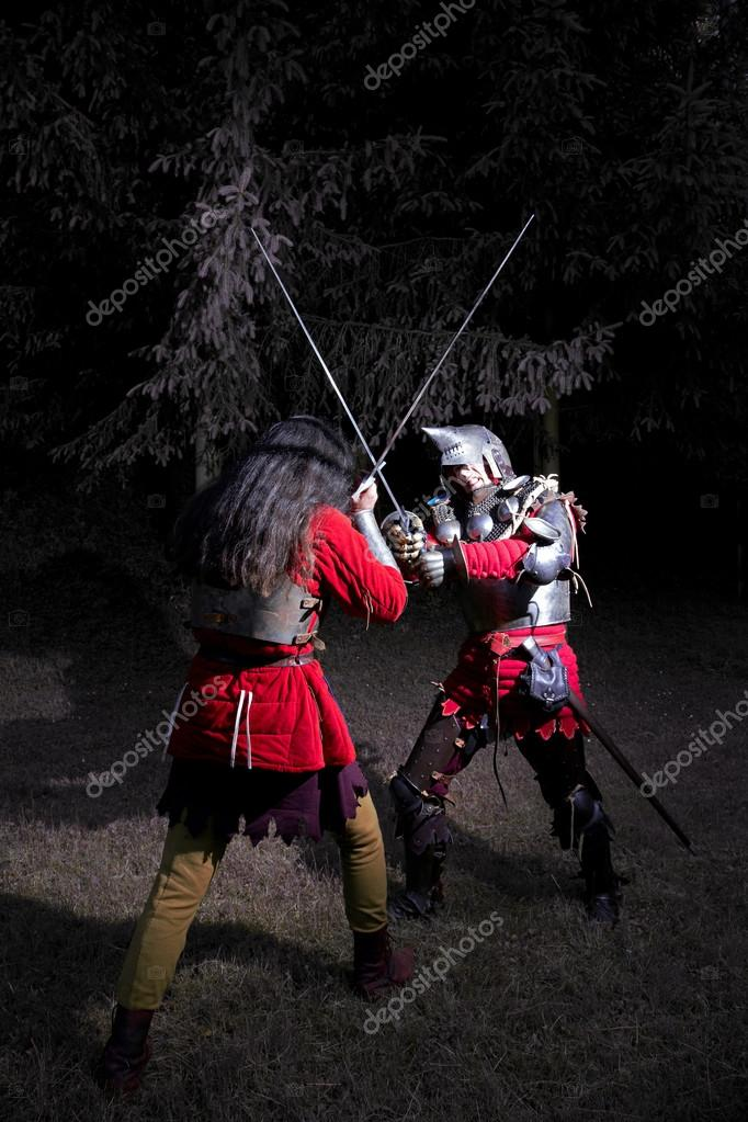 Two Knights Fencing in the Woods at Night — Stock Photo © likstudio