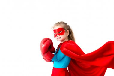 Superhero kid wearing boxing gloves Isolated on white background.