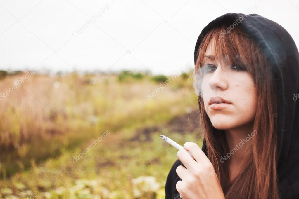 Smoking girl with cigarette