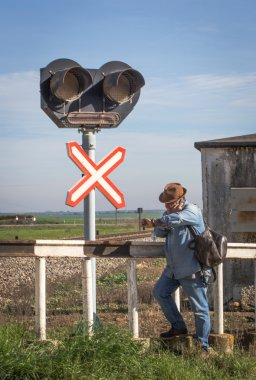Adult traveller sitting on rails