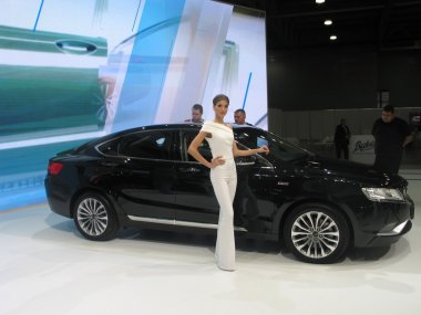 Girl model near to the machine. Moscow International Auto Show 2016. August 29th, 2016 Moscow. Russia