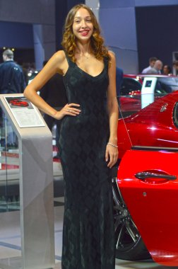 Moscow International Automobile Salon Women from Maserati team Red car