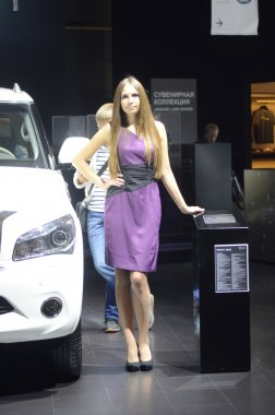 Moscow International Automobile Salon Young Brunette Women from Infiniti Team in violent dress  Autumn