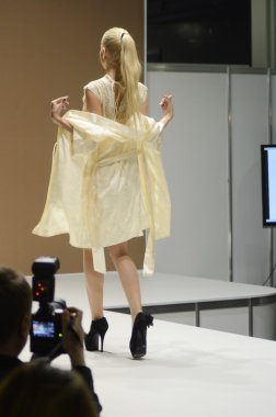 Intercharm XXI International Perfumery and Cosmetics Exhibition Lingrie Expo Traffic Young beautiful blonde in a light lemon dressing gown Motion