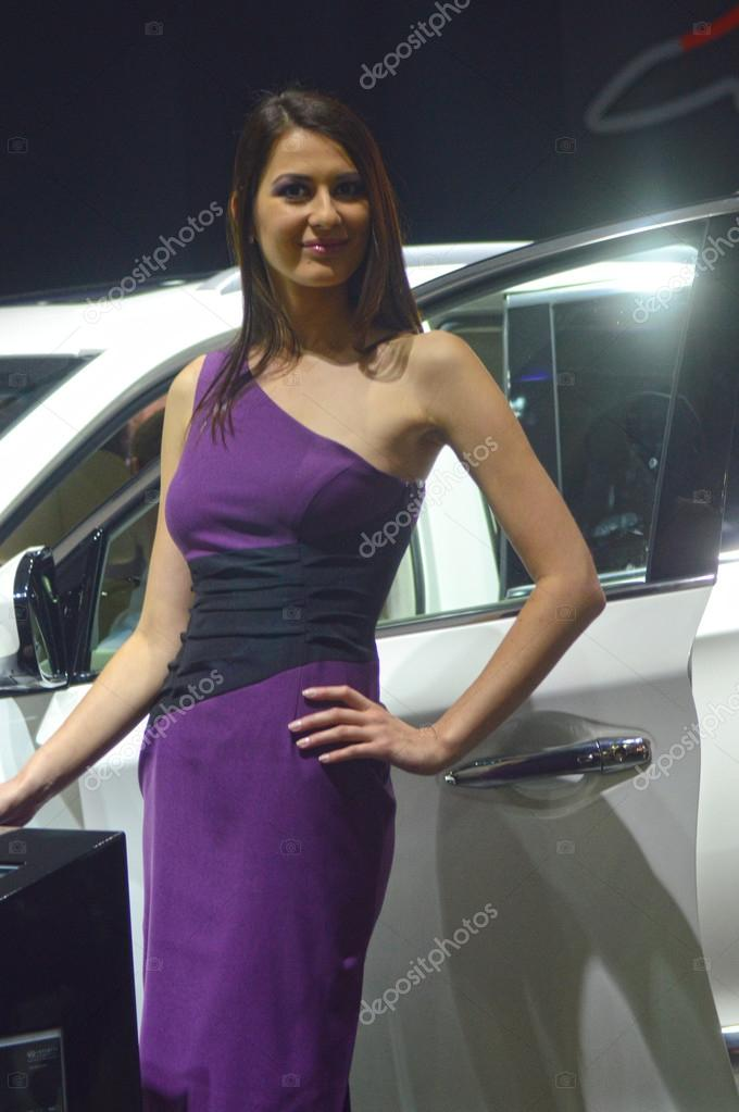 Moscow International Automobile Salon Young Women from Infiniti Team in violent dress Autumn