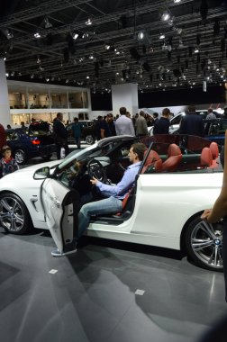 BMW fourth series. Cabriolet White Color. Traffic Moscow International Automobile Salon