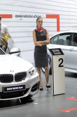 BMW 235i Coupe White Color Women from BMW Team Moscow International Automobile Salon