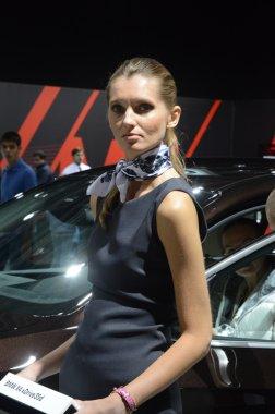 Women from BMW team. Look BMW x4 xDrive 35d Traffic Moscow International Automobile Salon