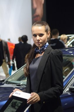 Moscow International Automobile Salon A young woman from the team BMW near car. BMW 316i Look