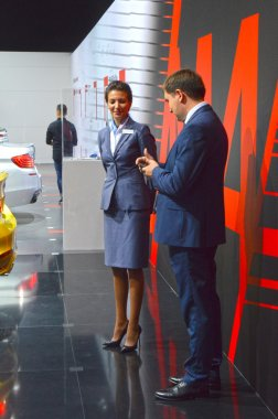 International Automobile Salon BMW team talking