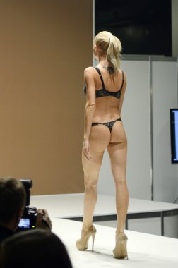 Moscow Traffic 5th International Exhibition of underwear, beachwear, home wear and hosiery Lingrie Expo Young beautiful blonde woman in black lingrie
