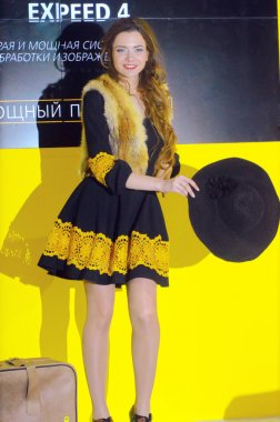 Photo Expo-2015. Moscow girl model posing in extravagant costumes fox Alice with a suitcase and a hat