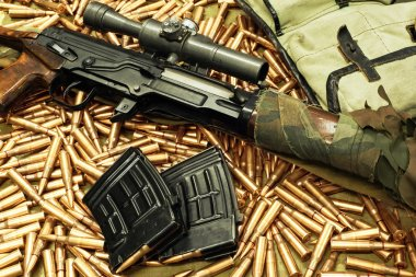 sniper rifle with weapons holders on the loose cartridges