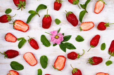 Sweet red strawberries on old white table, view from above, studio shot