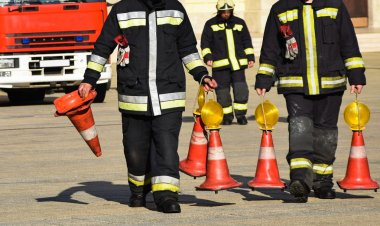 Firefighters with traffic cones
