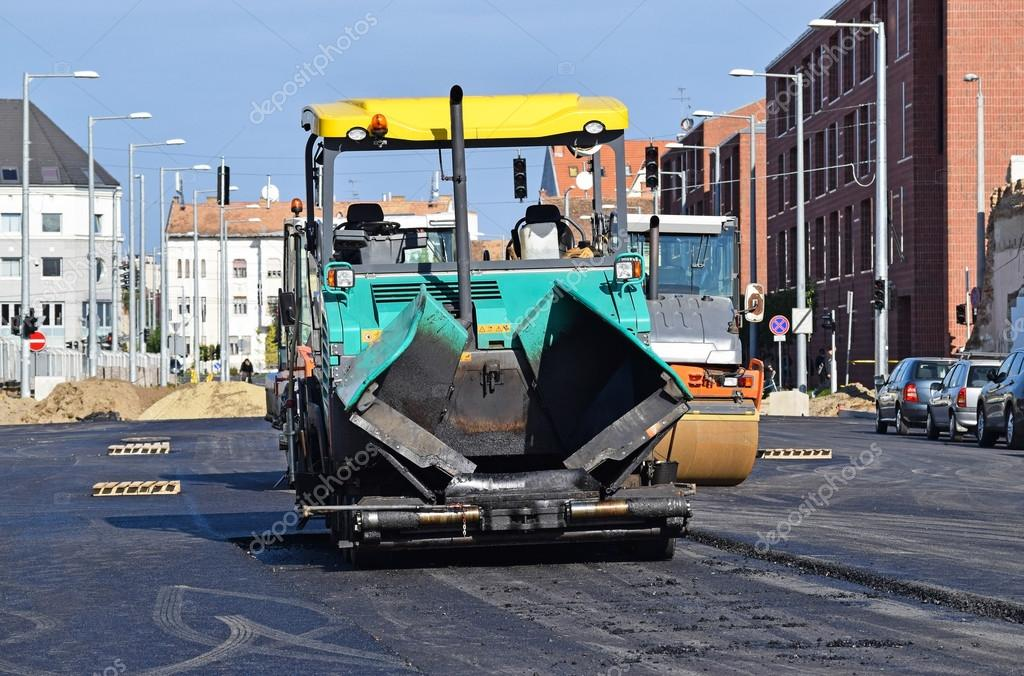 Asphalt paving vehicle at the road construction