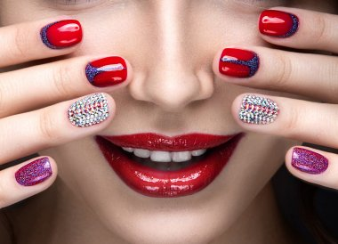 Beautiful girl with a bright evening make-up and  manicure with rhinestones. Nail design. Beauty face.