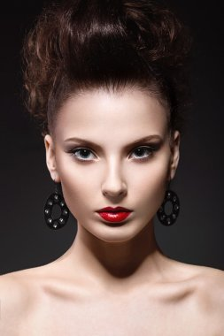 Beautiful brunette girl with evening make-up and perfect skin. Beauty face.