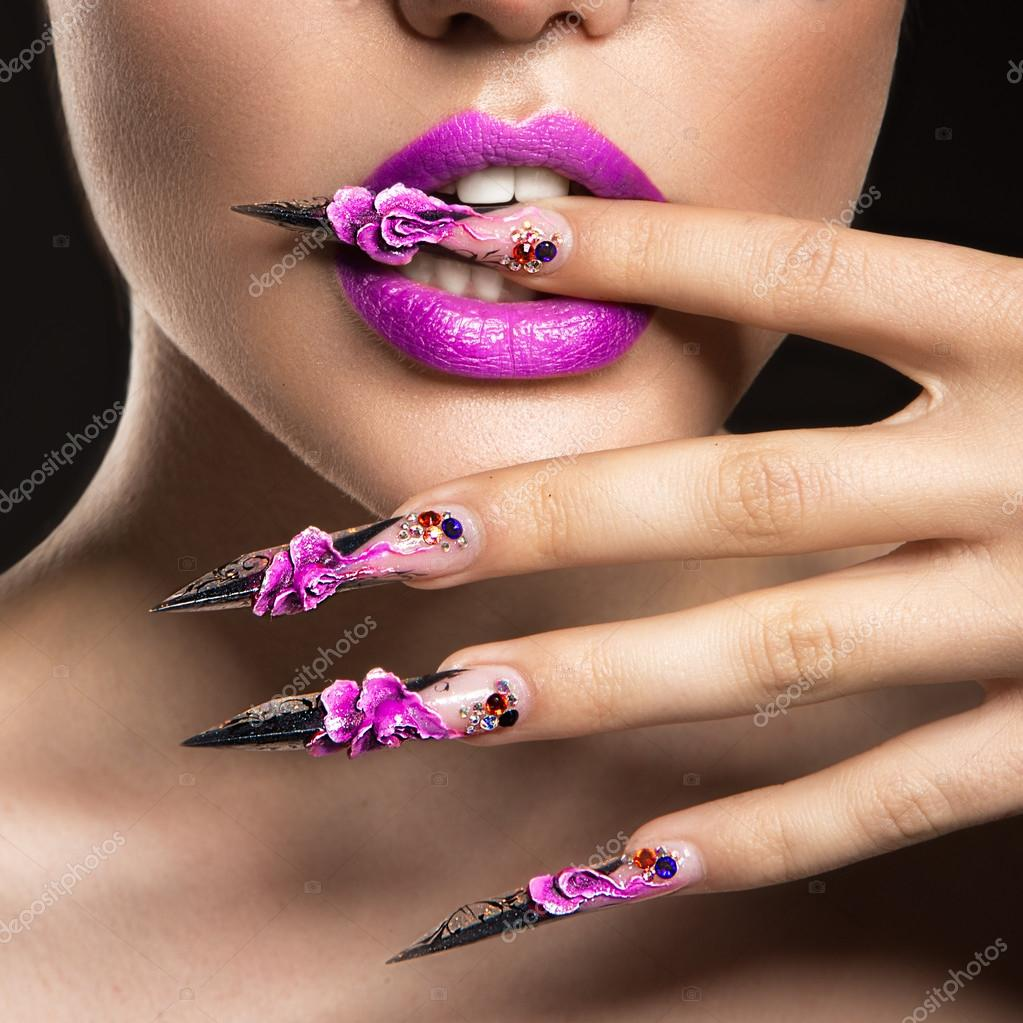 Beautiful girl in mask with long nails and sensual lips. Beauty face ...