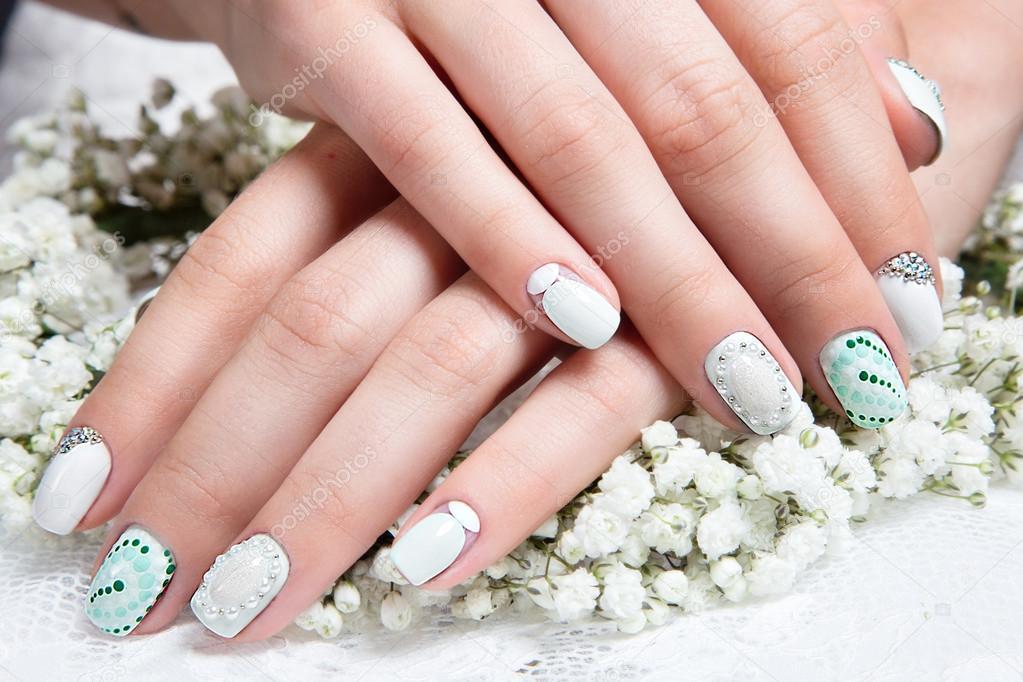Wedding manicure for the bride in gentle tones with flowers nail wedding manicure for the bride in gentle tones with flowers nail design close prinsesfo Images
