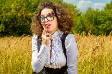 Beautiful woman in glasses having fun outdoors