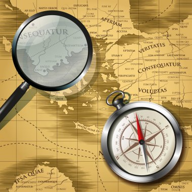Magnifying glass and compass over old map