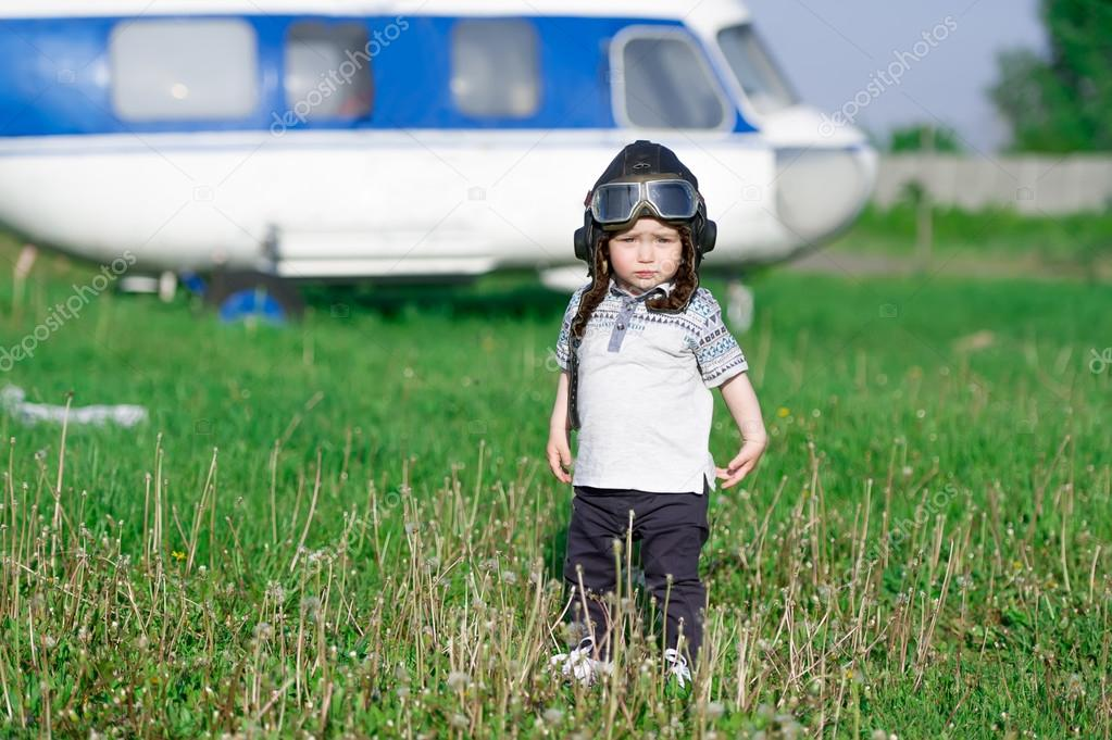 the child in the form of the helicopter pilot
