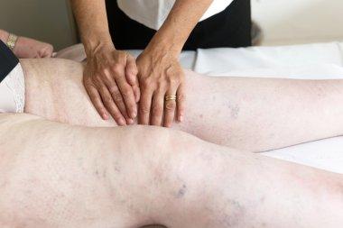 Woman doing lymphatic drainage massage