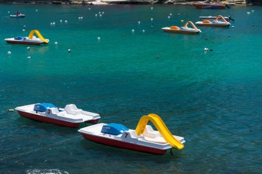 Pedal-boats with water slide
