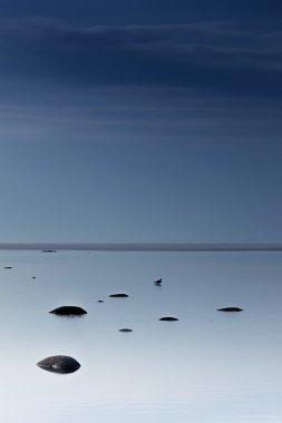 Cloudy blue minimalist seascape. Deserted space. Horizon line. Background.
