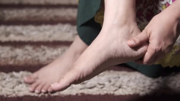 young women massaging on feet and suffering pain