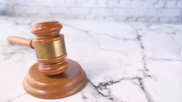 close up of gavel and cash on white background