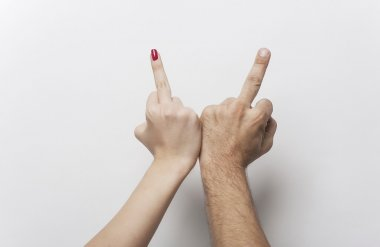 Couple making middle finger irreverent gesture