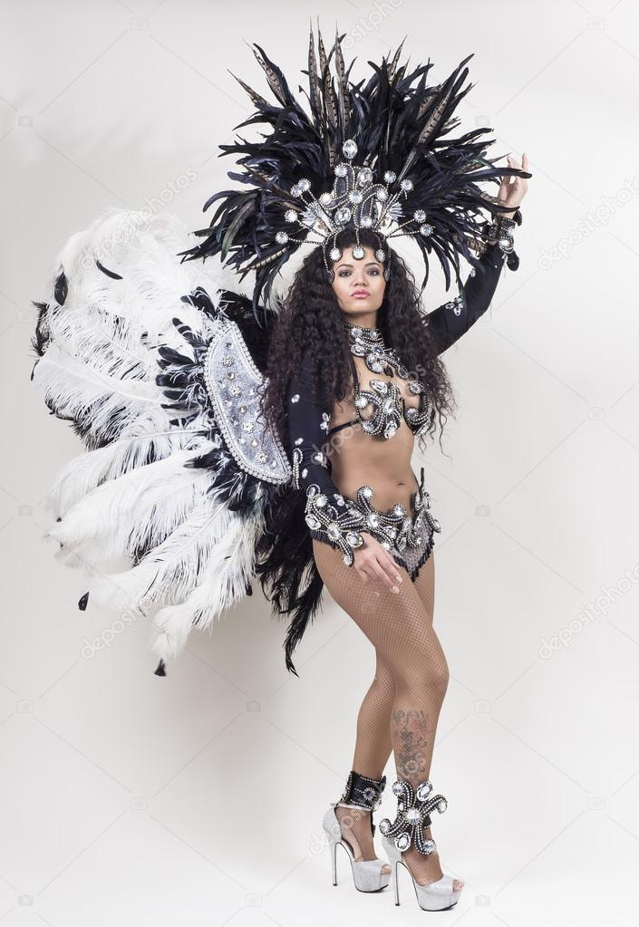 Samba dancer wearing traditional costume and posing