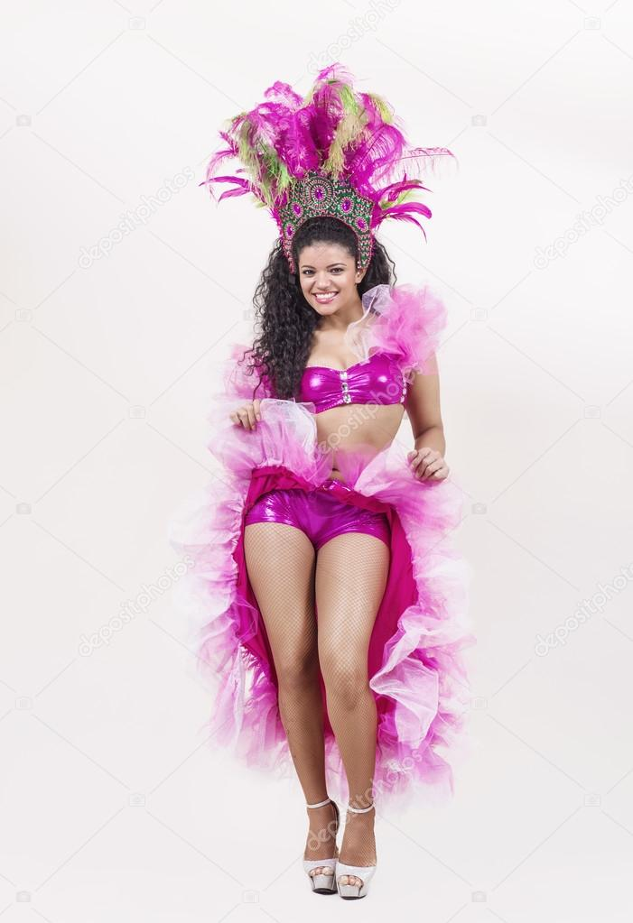 Smiling samba dancer wearing traditional pink costume