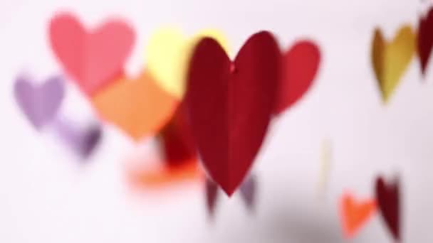 Blurry background with paper hearts spinning and moving