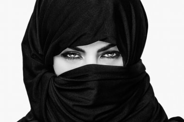 Girl wearing burqa closeup black and white