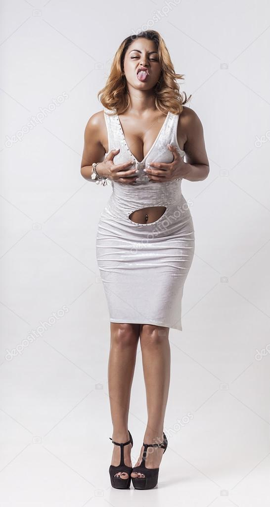 Méprisant et drôle femme toucher ses seins — Photographie patronestaff © #64839557