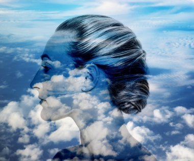 Double exposure of pretty girl profile and cloudscape