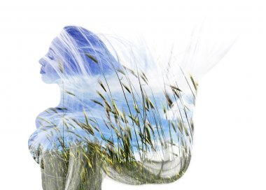 Double exposure of happy girl dancing and wheat field
